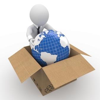 Человек держит землю в картонной коробке