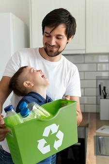 Man and kid recycling medium shot