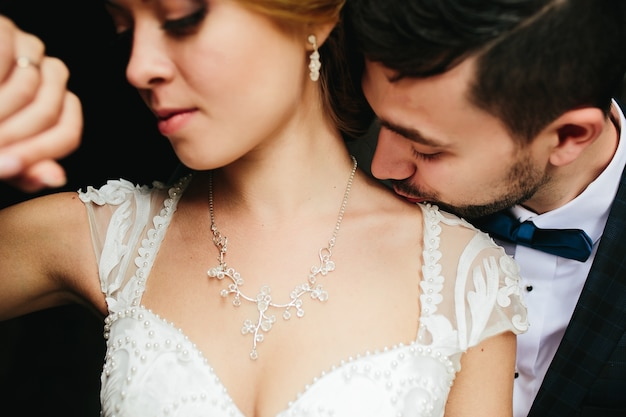 Man kissing his bride