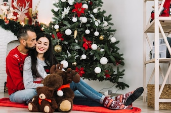 Man kissing woman near soft toys