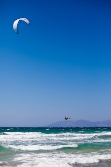 Man kitesurfing on the mediterranean sea