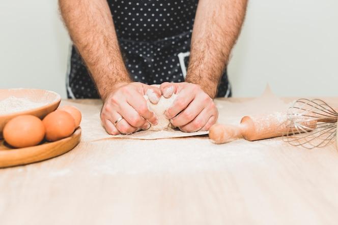 Man kneading fresh dough