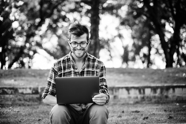 Man laptop browsing searching social networking technology concept