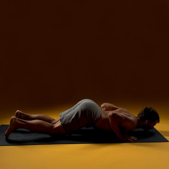 Man laying down on yoga mat