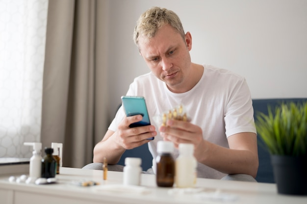 Man learning about his pills