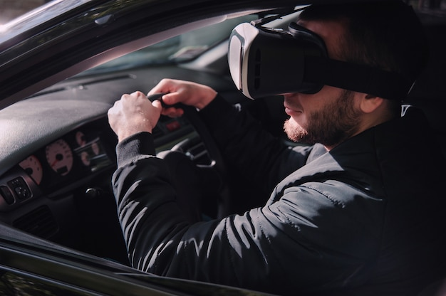 Man learning to drive with virtual reality glasses