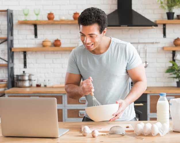Man learning how to cook from online courses