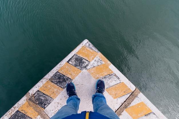 Man legs on corner of docks