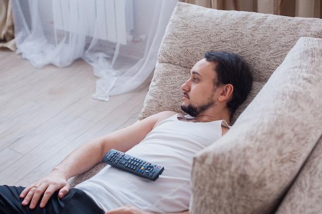 Man lies on the sofa