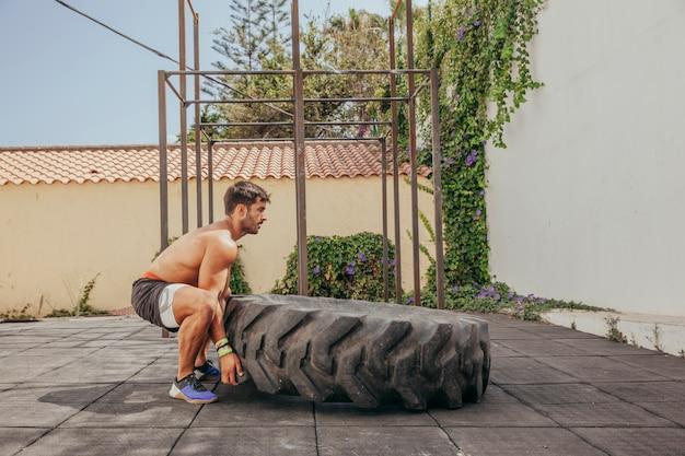 Man lifting wheel