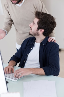 Man listening to colleague explanation