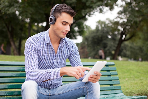 Man listening to music in a city park