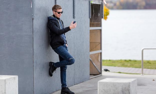 Man listening to music on earphones outdoors