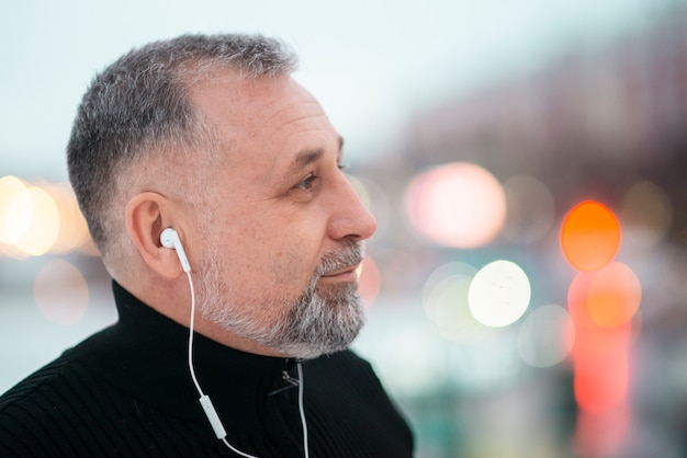 Man listening to music outside with copy space