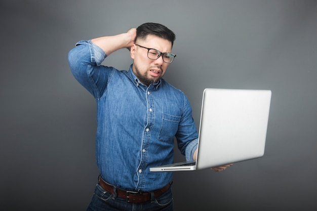 A man looked at the computer in surprise.