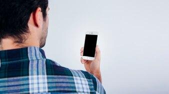 Man looking at smartphone screen