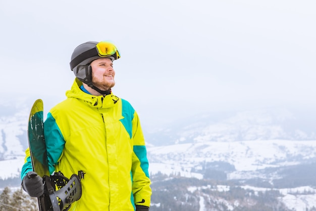 Man looking at free space in ski snowboard outfit winter extreme activities
