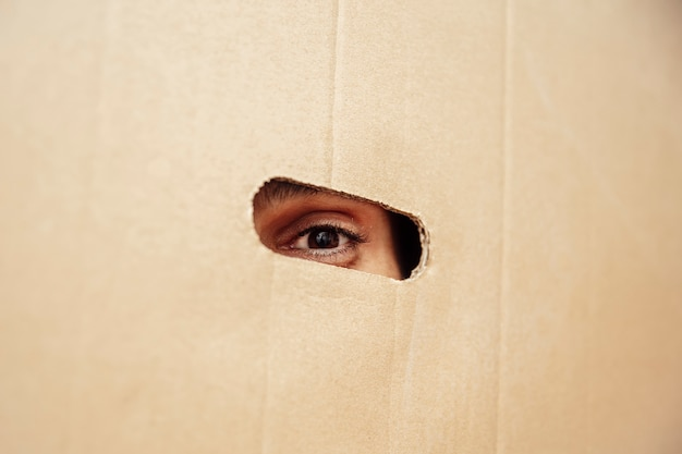 Man looking from the cardboard box