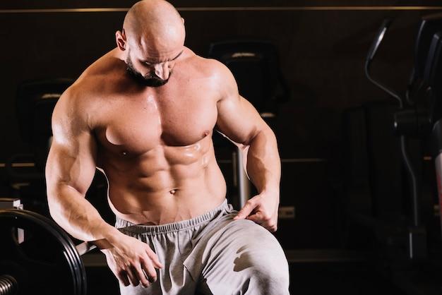 Man looking at his sweatpants