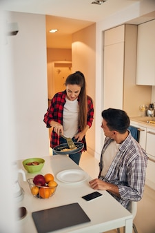 Man looking at his wife with a skillet