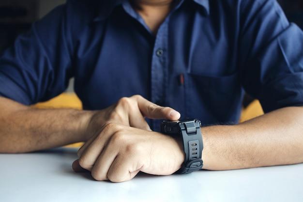 Man looking his wristwatch
