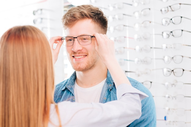 Man looking for new glasses at optometrist