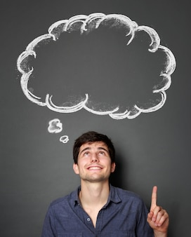 Man looking and pointing up to blank bubble speech
