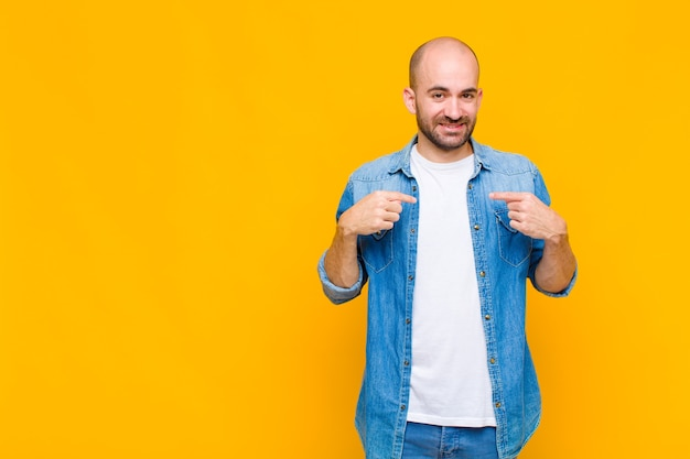 Man looking proud, positive and casual pointing to chest