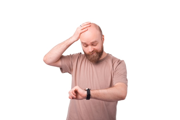 Man looking stressful at watch on white