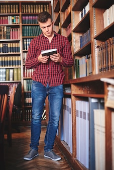 Man looking for study material