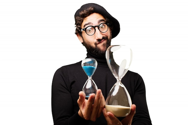 Man looking at two hourglasses