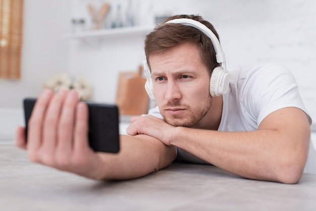 Man looking at a video on his phone