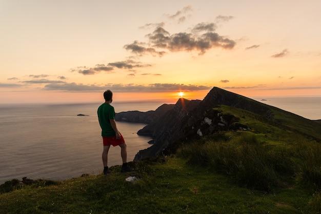 Man looking at the view of croaghaun cliffs on achill island ireland