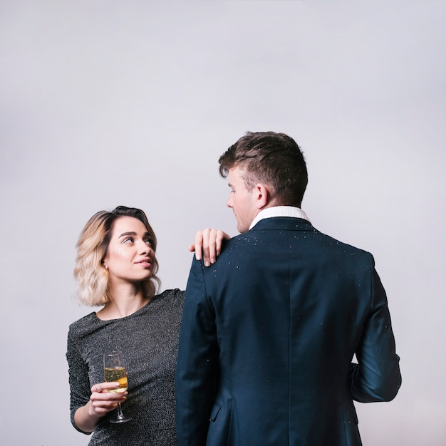 Man looking at woman with champagne glass