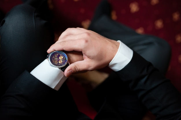 A man looks at his watch.