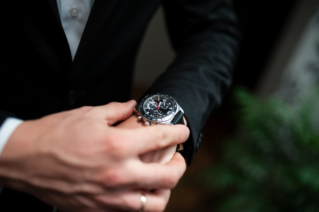 A man looks at his watch