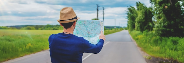 A man looks at a map on the road
