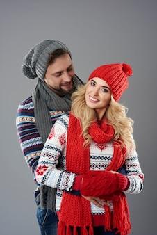 Man in love embracing his girlfriend