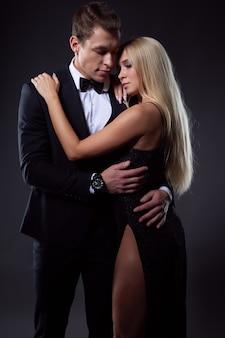 A man in love gently hugs his beloved woman