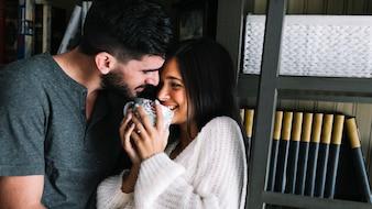Man loving her girlfriend holding coffee mug
