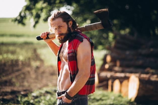 Man lumberjack in forest