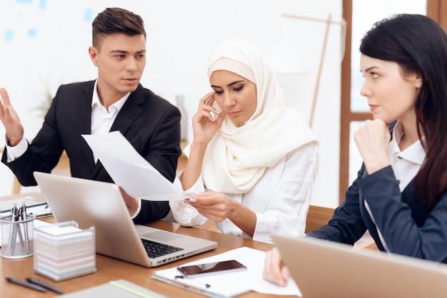 A man makes a claim to a woman wearing a hijab