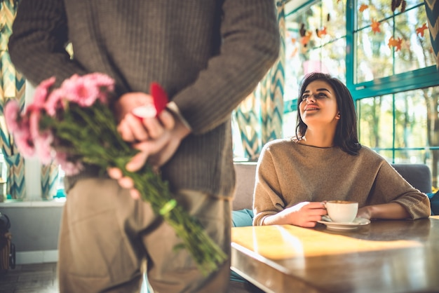The man makes a proposal to his girlfriend in the restaurant