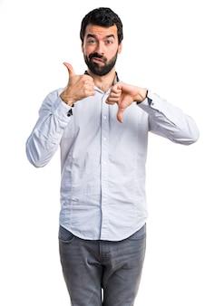 Man making good-bad sign