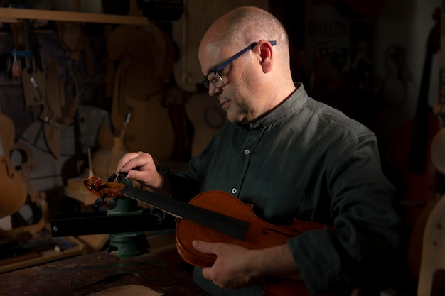 Man making instruments in his workshop alone