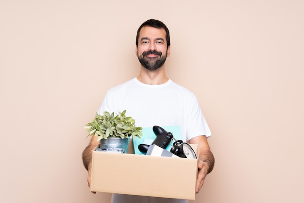 Man making a move while picking up a box full of things