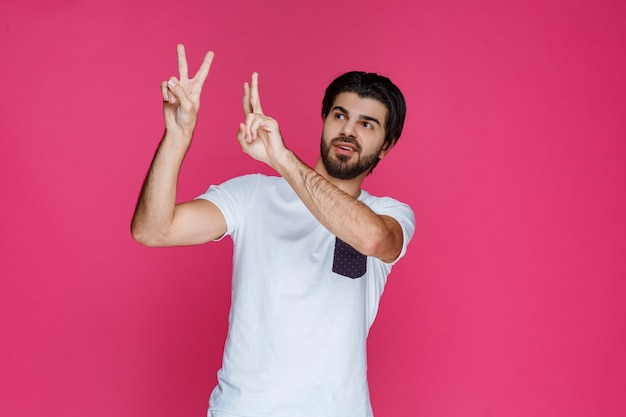 Man making peace and friendship hand sign.