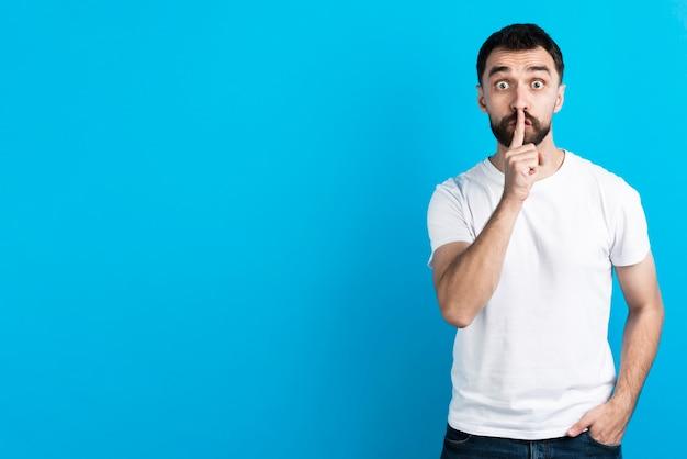Man making quiet gesture