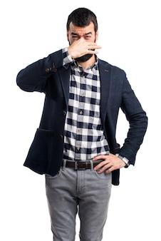 Man making smelling bad gesture