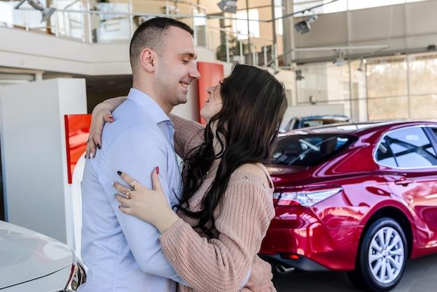 Man making surprise for his wife in avto salon